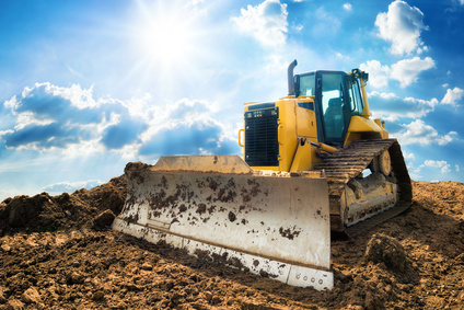 Excavator with blue sunny sky in the background